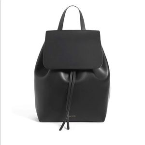 Black leather backpack, with red interior.